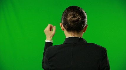 Woman is knocking on a green screen.FULL HD