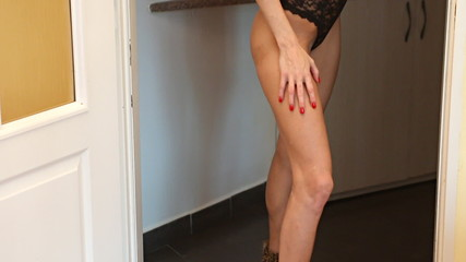 Pan up on sexy shoes and legs woman in lingerie