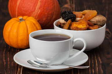 Autumn Concept. Cup Of Tea Or Coffee. Dried Fruits. Pumpkins. Wo
