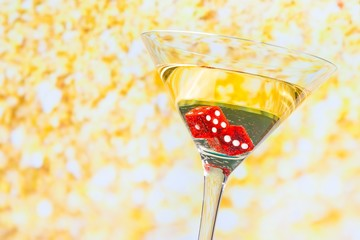 red dice in the cocktail glass on golden