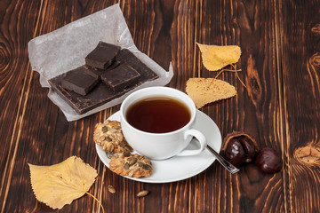Cup Of Tea Or Coffee. Dark Chocolate. Cookies With Seeds. Wooden