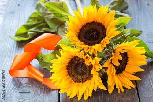 canvas print picture Sunflowers on table