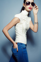 Eyewear concept. Fashionable beautiful young woman in jeans
