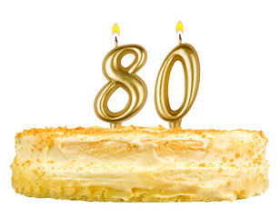 birthday cake with candles number eighty isolated