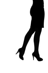 Silhouette of young woman in high heels, low section