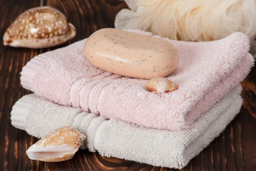 Soap, Towels. Sea Shells. Wooden Background