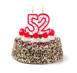 Geburtstagstorte mit brennender Kerze Nummer 52