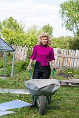 Blonde with garden wheelbarrow