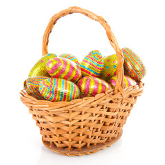 Cane basket with colorful easter eggs