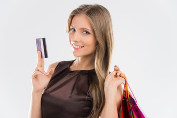 Portrait of young beautiful smiling woman with credit card.