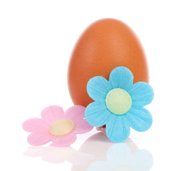 One chicken egg with pink and blue flower