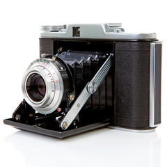 Old fashioned photo camera on white