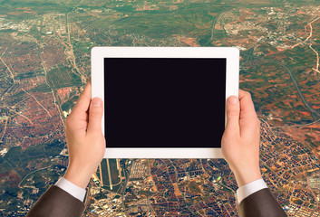 Hands holding tablet pc with empty screen