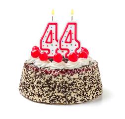 Geburtstagstorte mit brennender Kerze Nummer 44