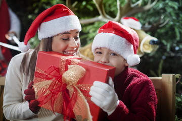 happy mother and son for the gift that brought Santa Claus
