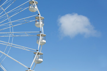Ferris wheel isolated against blue
