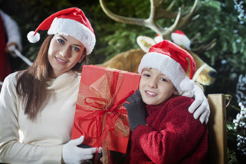 mother and son show the gift that brought Santa Claus