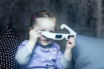 Portrait of young girl holding 3D glasses