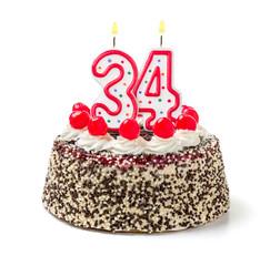 Geburtstagstorte mit brennender Kerze Nummer 34