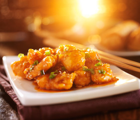 colorful chinese sesame chicken dish with lens flare