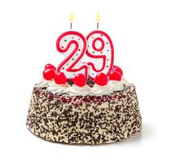 Geburtstagstorte mit brennender Kerze Nummer 29