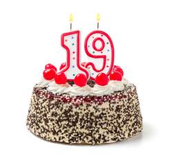 Geburtstagstorte mit brennender Kerze Nummer 19