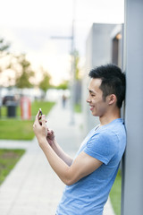 Young asian man with cell phone