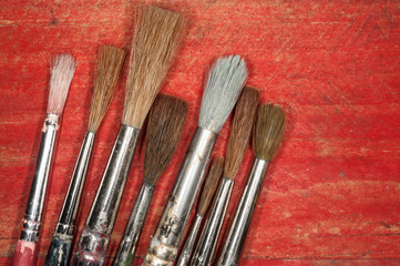 paint brush bristles on wooden background