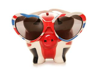 piggy bank wearing heart shape glasses
