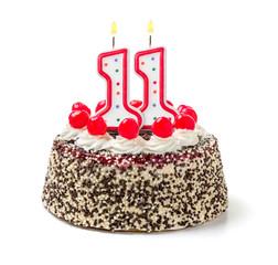 Geburtstagstorte mit brennender Kerze Nummer 11