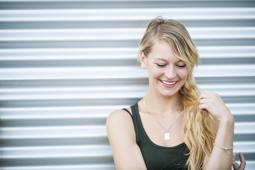 Smiling young blond woman