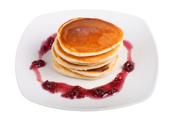 pancakes with raspberry jam on a white plate isolated on white b