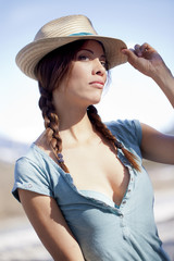 Pretty lady holding an straw hat