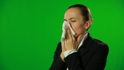 Businesswoman sneeze, green screen. FULL HD