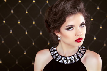 Beautiful brunette woman model with makeup and hairstyle. Fashio