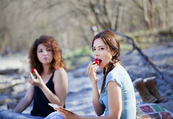 Women eating strawberries