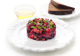 Traditional Russian vegetable salad Vinaigrette with beetroot
