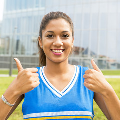 Portrait of smiling beautiful latin woman with thumb up gesture,