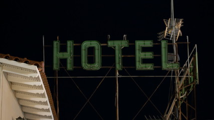 Timelapse of hotel banner blinking at night
