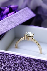 gold ring with diamond in a beautiful box