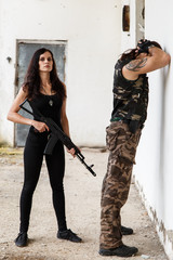 Guy with girl on a battlefield