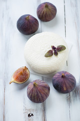 Still life food: cheese and figs, rustic wooden surface
