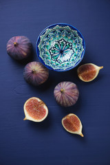Above view of fig fruits over dark blue wooden surface