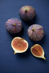 Close-up of whole and sliced figs, above view, vertical shot
