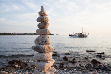 stacked rocks beach boat