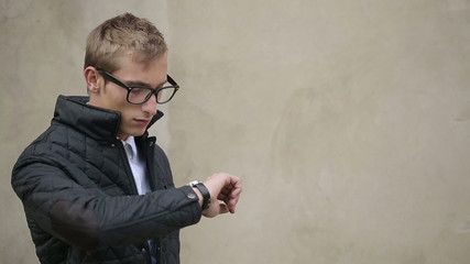 Attractive Guy Looks at his Watch