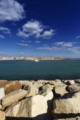 Italy, Sicily, Scoglitti, a fishing boat entering the port