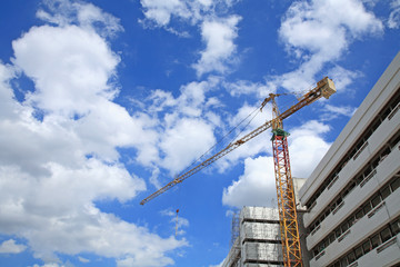 Yellow crane at construction site