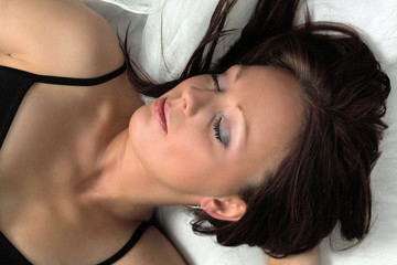 Woman in deep sleep in bed