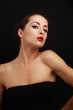 Beautiful sexy female model posing in black dress